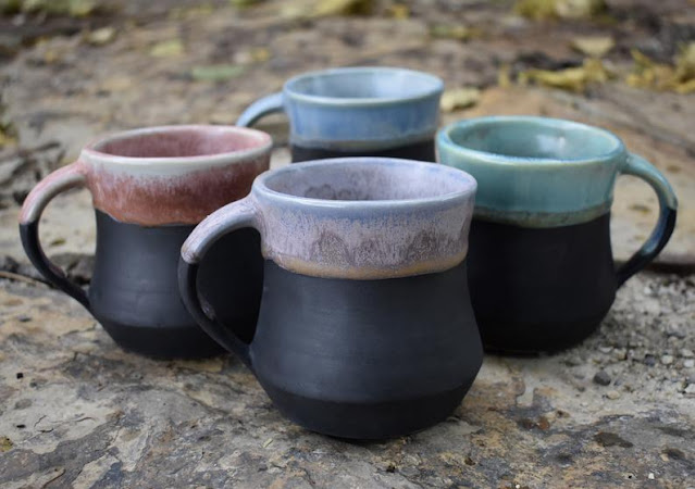 Mugs with a black base and rims with soft colors of all hues
