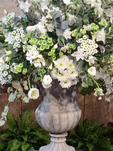 fresh white and green urn floral