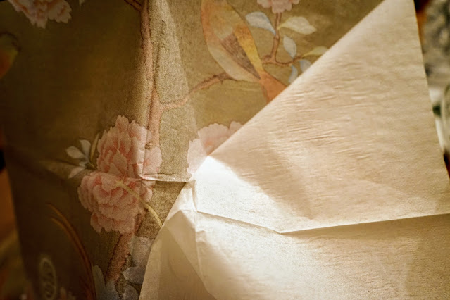 Removing second ply from paper napkins