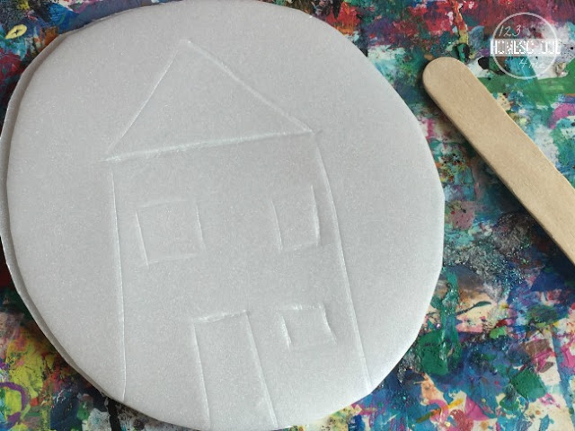 using a craft stick or stick draw design on styrofoam plate