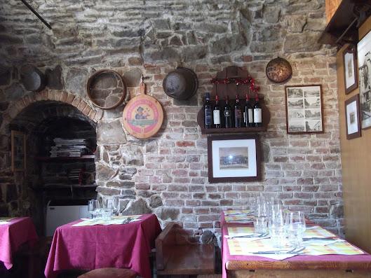 The original medieval brickwork is a feature of Trattoria Tre Torri's cosy interior