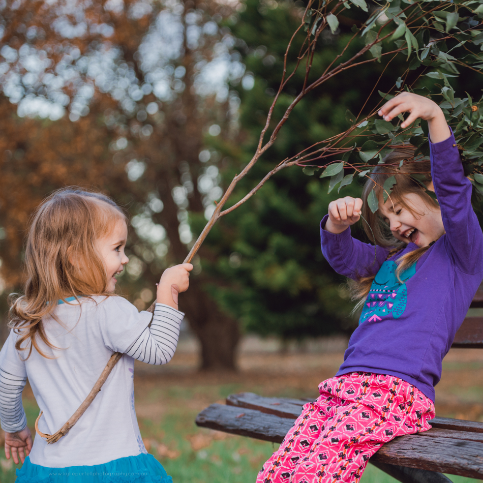 Two sisters playing outside