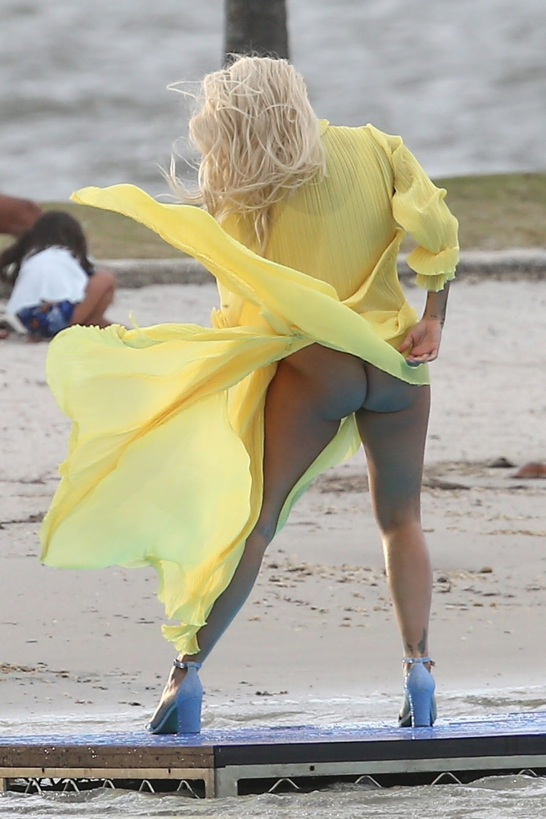 Rita Ora shows more than expected as she faces wardrobe malfunction during photoshoot
