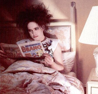 Robert Smith reading a comic book in bed, 1986