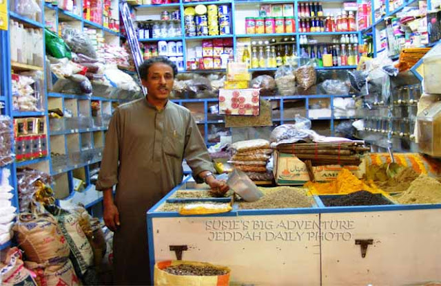 A shopkeeper standing in his shop