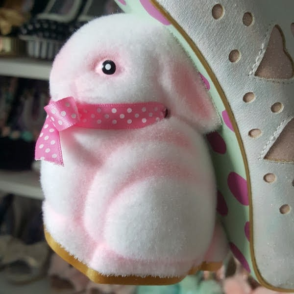 close up of fuzzy bunny shaped heel of shoe
