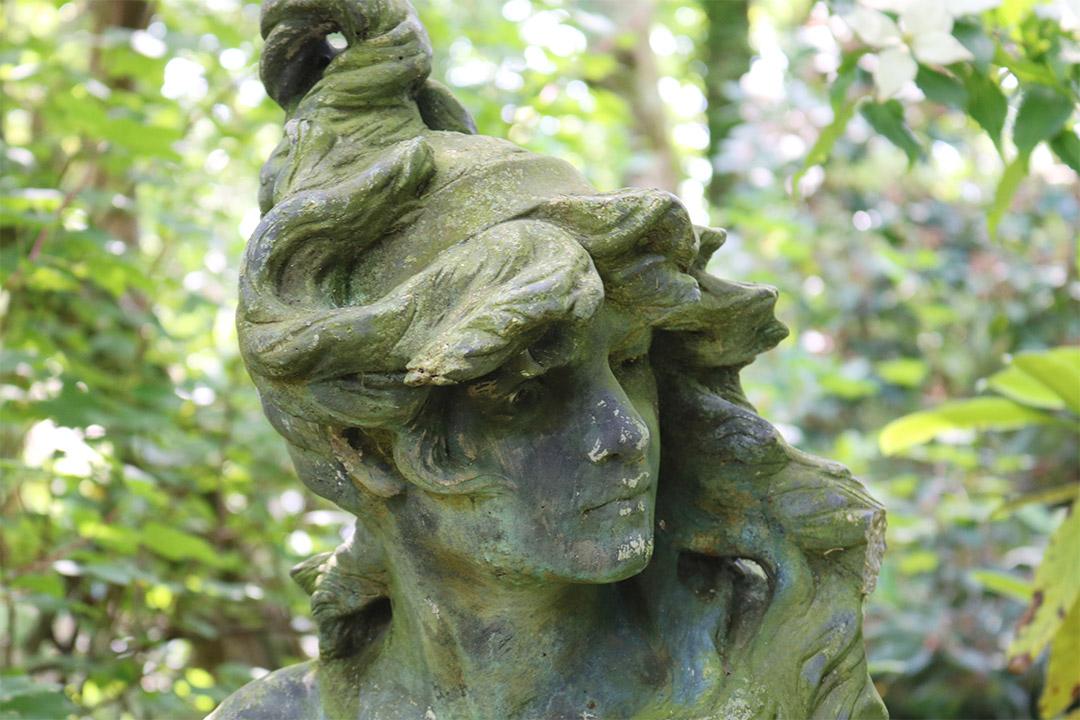 Weather-worn statue at Pinetum Gardens, Cornwall