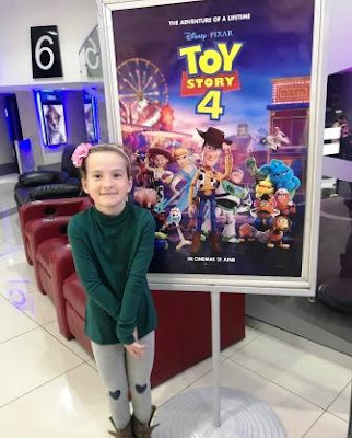 Girl in front of Toy Story 4 poster at Ster Kinekor Sandton City