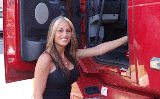 Jessica Samko posing for picture with a truck