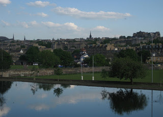 View of the city across the boating pond at Inverleith Park, Edinburgh, Scotland