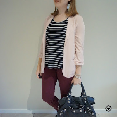 awayfromblue Instagram | blush and burgundy blazer and skinny pants business casual outfit with black tank statement earrings Balenciaga bag