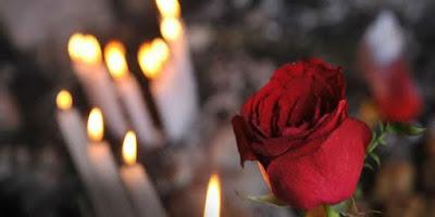 imagem de vela e rosas dia de finados