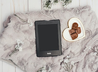 Image: Black Kindle Tablet on a Grey Floral Blanket. Photo by Adrienne Andersen from Pexels