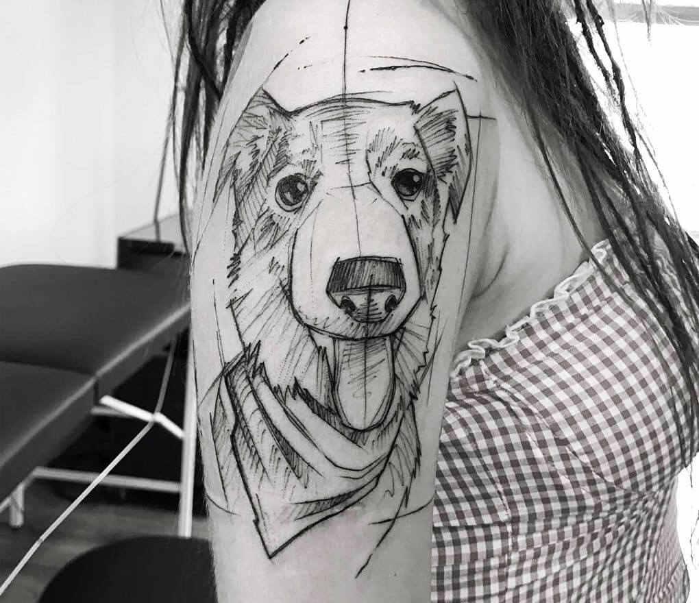 Simpático tatuaje de un perro en boceto