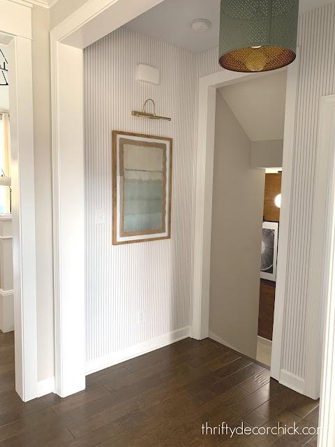 pinstripe blue white wallpaper hallway