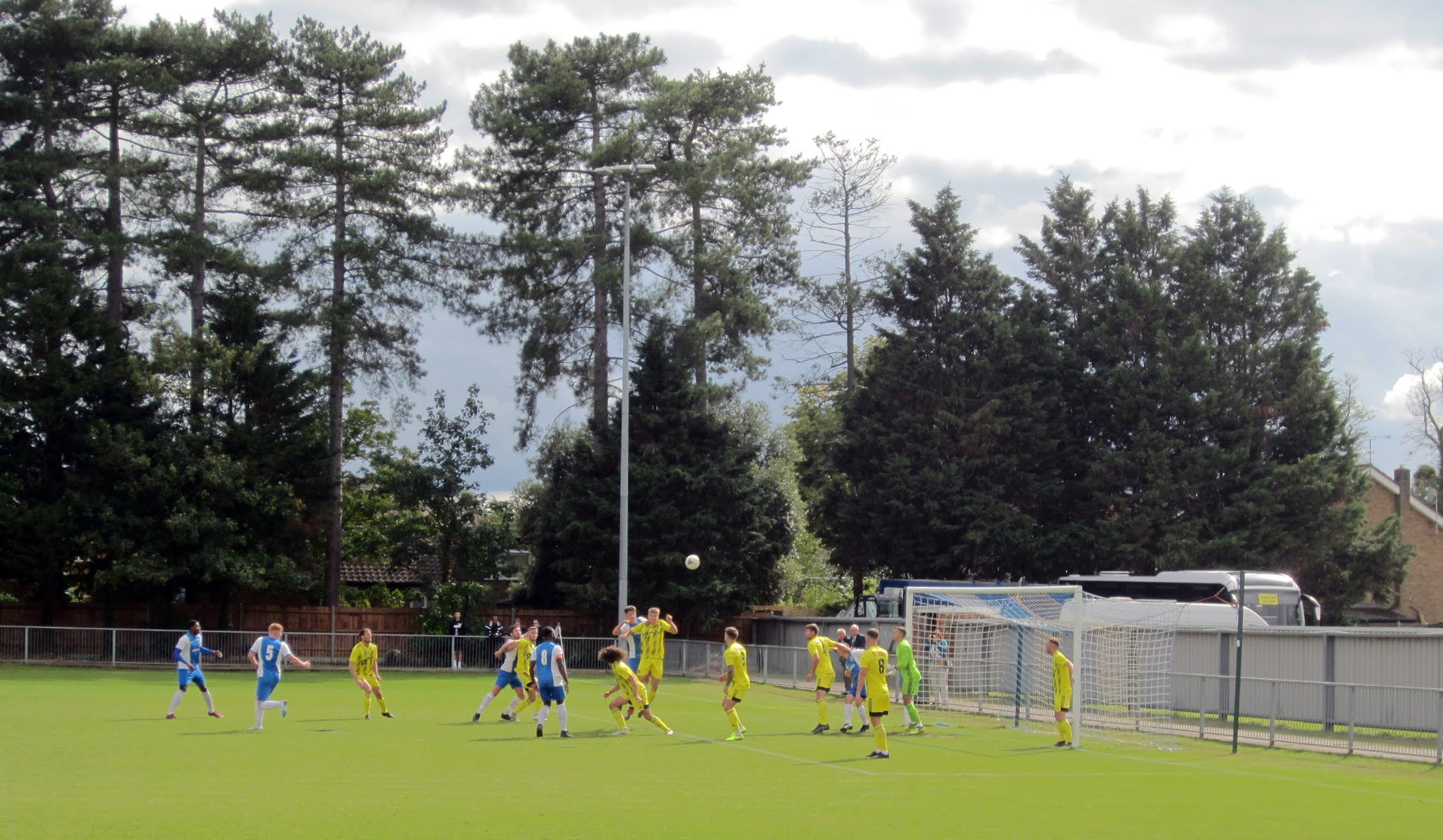 A contested header between Burnham and Tiverton Town