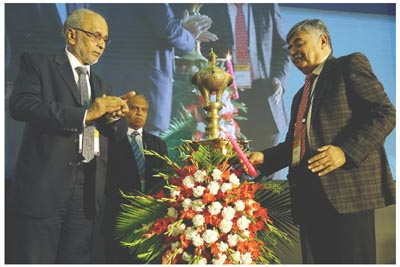 Bhaskar Bhat, MD ,Titan Co. Ltd with P. Ramadas, President, IMTMA, Indradev Babu, VP, IMTMA at NPS 2019 inauguration