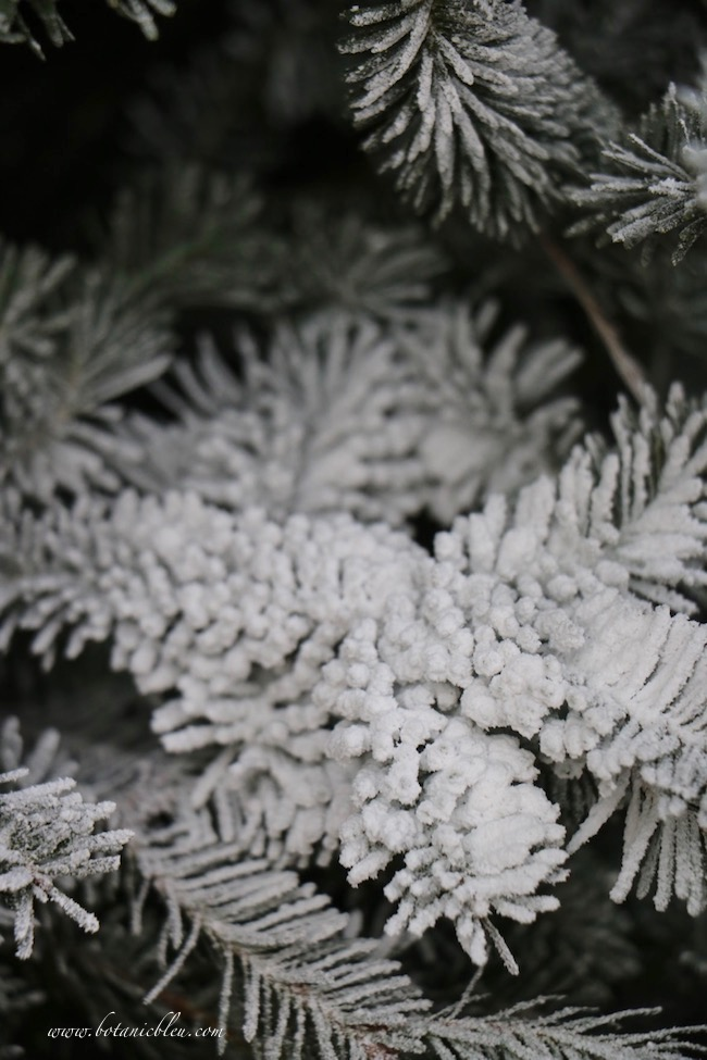 How NOT to DIY flock a Christmas tree shows photos of branches sprayed with spray snow from a can