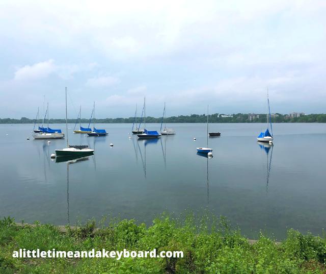 Boats bob slightly in the marina of Lake Bde Maka Ska in Chain of Lakes Minneapolis.