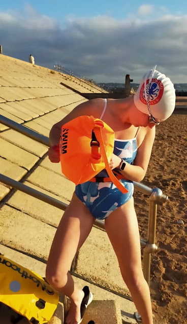 Here is Lizzie with a Swim Secure Dry Bag