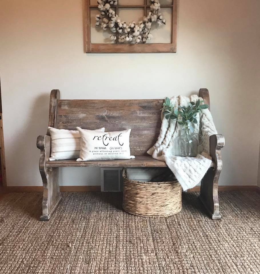 A church pew makes a great entryway bench in the vintage aesthetic