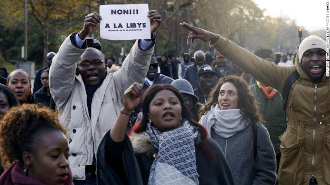 Protesters gather near Libyan Embassy after CNN report on migrant auctions