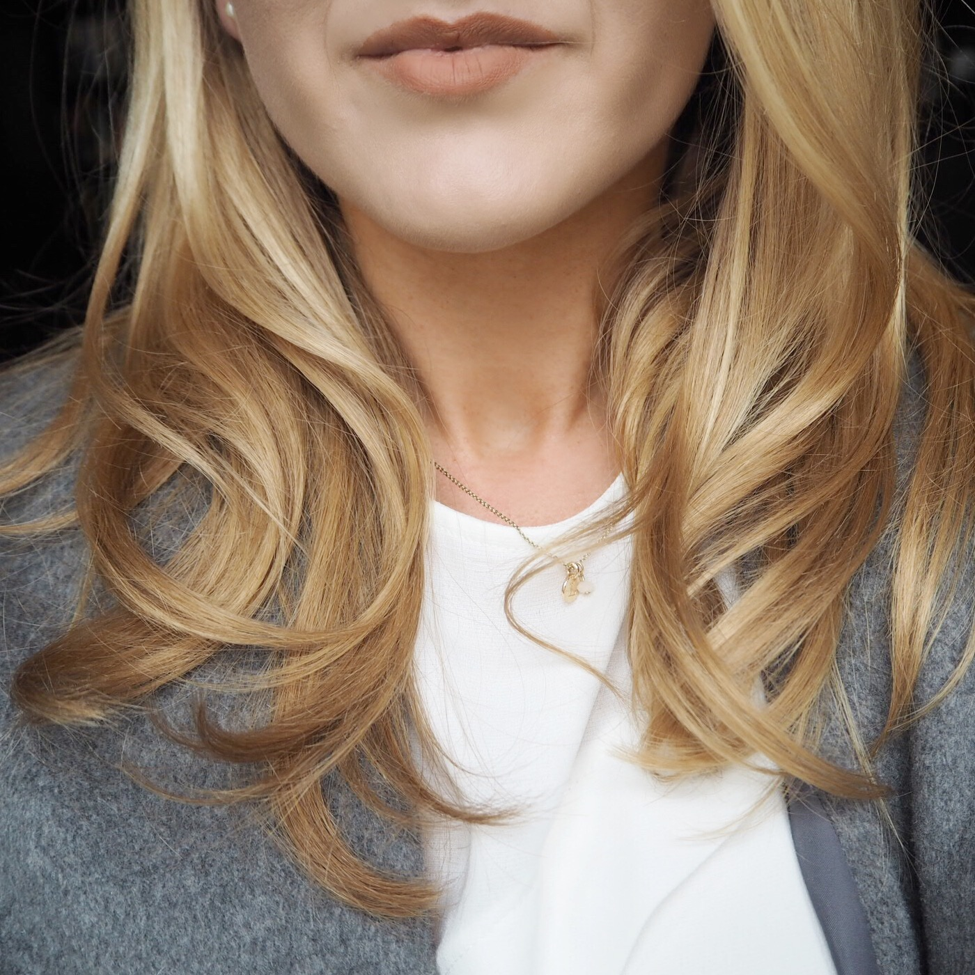 Blonde, blow dried hair