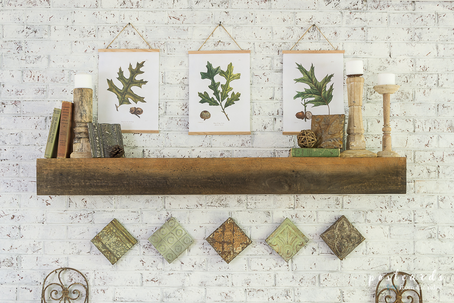 fall mantel with salvaged materials and vintage decor