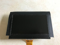 Screen edged with tape
