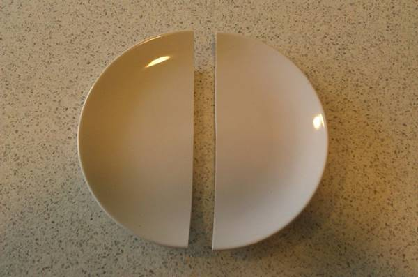 This plate was broken like it was cut by scissor.