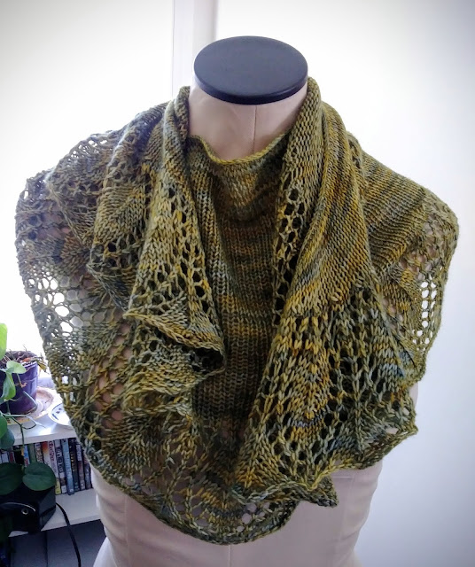 Simple shawl with lace border knit with Capretta from http://shrsl.com/1plh0