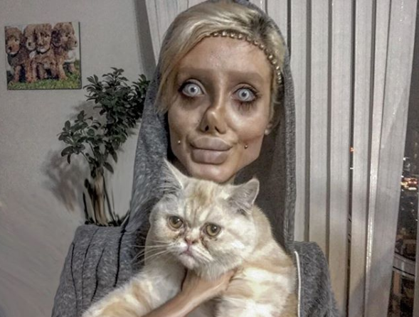 """""""Iranian Woman Who Got Hilarious Result After Undergoing 50 Surgeries To Look Like Angelina Jolie Reveals The Truth Behind Her Action @gmnaija.com"""""""