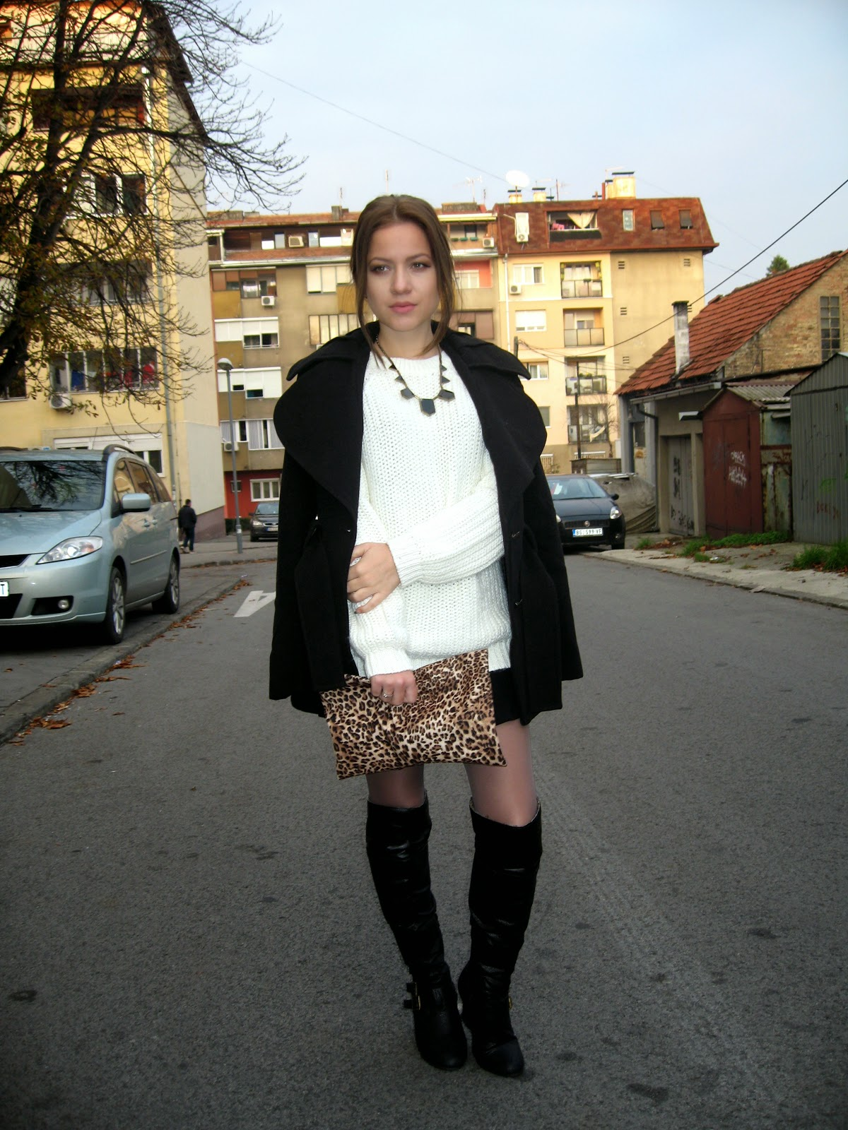 outfit, C&A white knit sweater, black flared high waisted shorts, over the knee boots, black coat, leopard print clutch bag