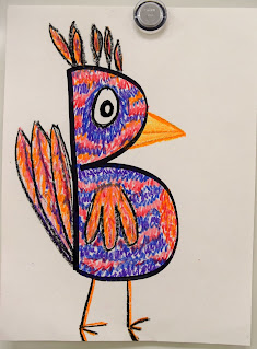 Child's drawing of a bird made from a letter of the alphabet