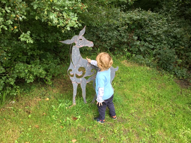toddler-touching-metal-dear-statue-cwm-carn-forest