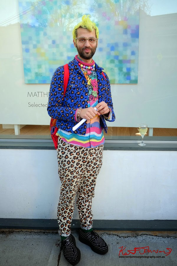 Gary Bigeni wearing Gary Bigeni leopard print and Romance Was Born shirt outside Olsen Irwin Gallery Paddington Sydney.