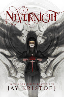 Cover of Nevernight, featuring a masked girl with long, dark hair. She stands against a white stone wall carved with coats of arms, her blood-drenched hands clasped around a white dagger. Shadowy wings rise from her shoulders.