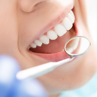 consult the dentist in regular check ups