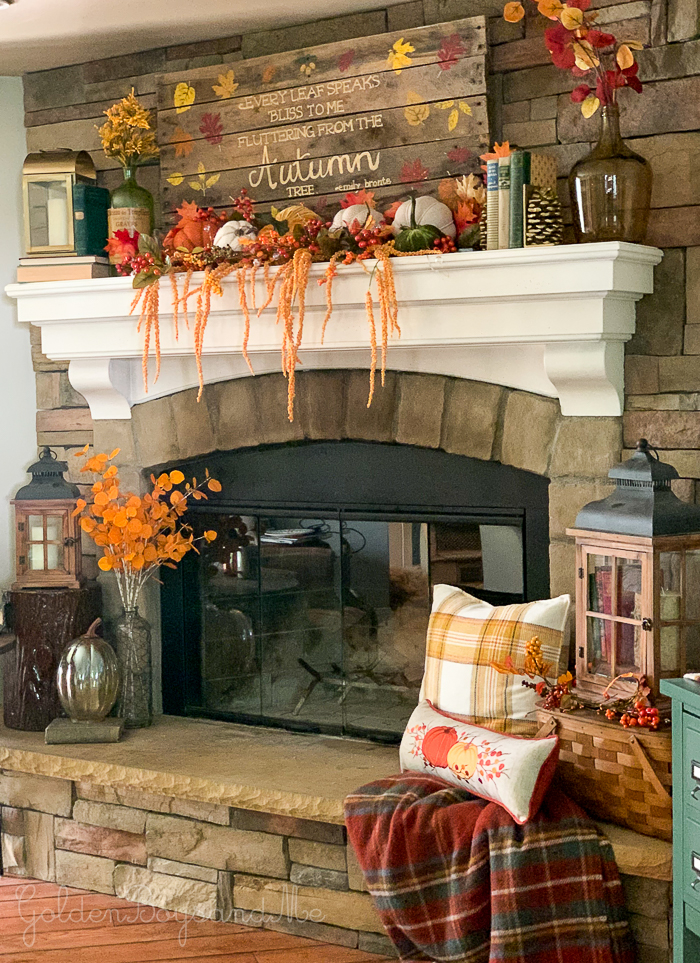 Corner stone fireplace in family room with rustic fall decor - www.goldenboysandme.com