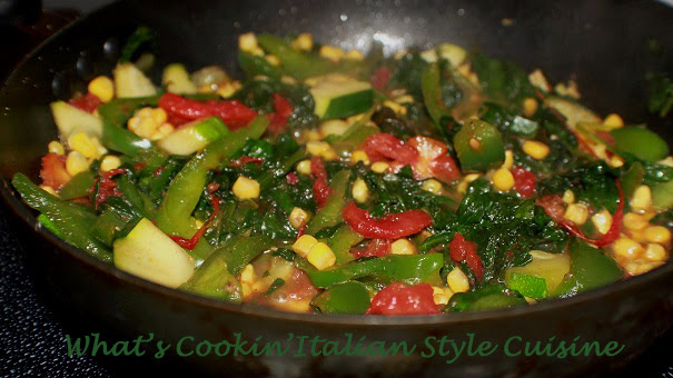 this is a side dish with zucchini, spinach and corn plus sliced tomatoes.