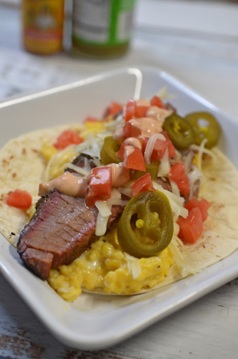 Green chile brisket breakfast tacos cooked on a big green egg kamado grill