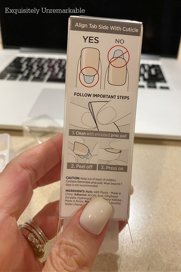 Hand holding Press On Nails Instructions