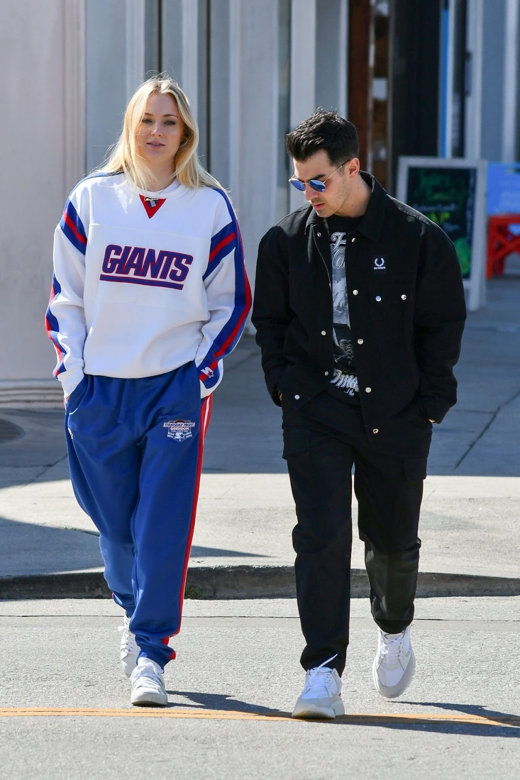 Sophie dressed down in a New York Giants hoodie with matching track pants