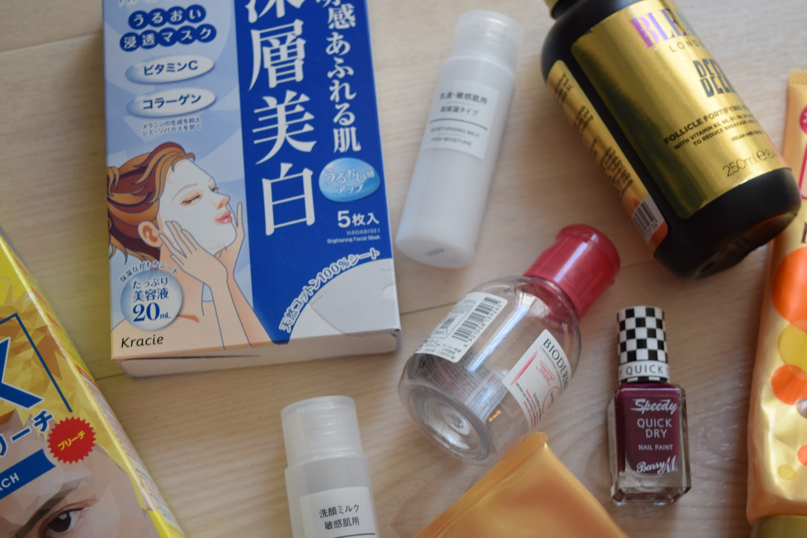 flatlay of empty beauty products including gatsby bleach, muji cleanser and bleach london shampoo