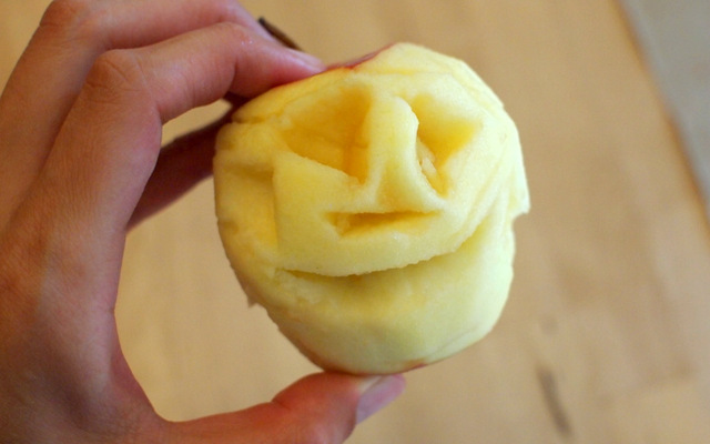 carved apple face for shrunken apple head
