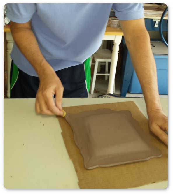 Clay formed by hand not on a potter's wheel