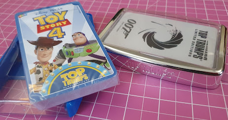 Top Trumps Toy Story and special edition 007 card games in packaging on table
