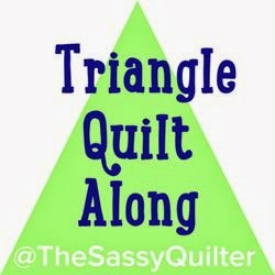 http://www.sassyquilter.com/triangle-quilt-along/
