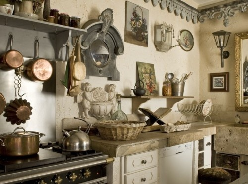 a collection of flea market and vintage finds make this kitchen an eclectic, inspirational space