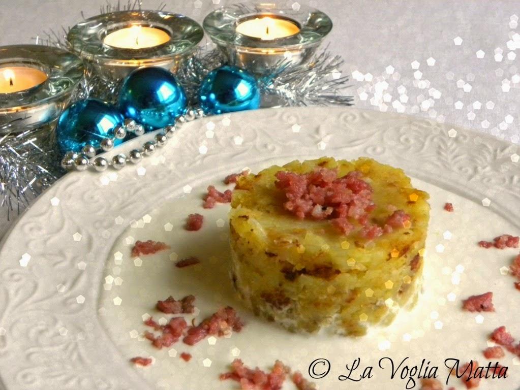 tortino di patate in tecia con fonduta di quartirolo  e salsiccia